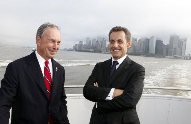 New York Mayor Michael Bloomberg, left, and French President Nicolas Sarkozy converse as they travel across New York Harbor to take part in a ceremony in anticipation of the 125th anniversary of the Statue of Liberty on Liberty Island, Thursday, Sept. 22, 2011 in New York. UPI/Jason DeCrow/POOL
