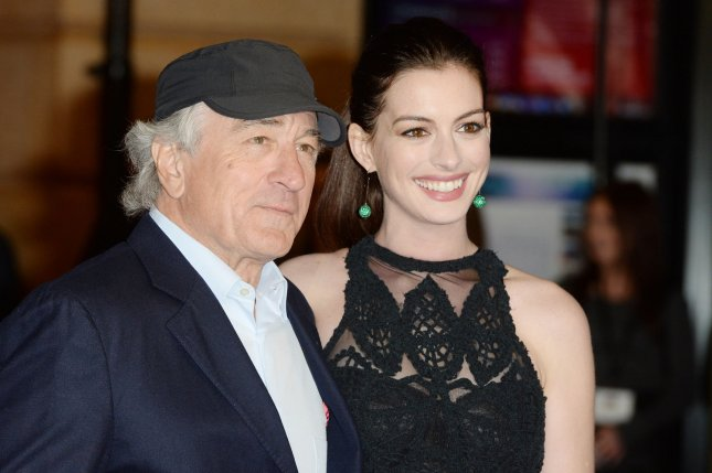 Anne Hathaway and actor Robert De Niro at the London premiere of The Intern on September 27, 2015. The actress recently dyed her hair strawberry blonde. File Photo by Rune Hellestad/UPI
