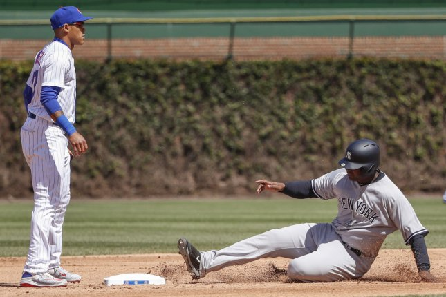 New York Yankees 1B Chris Carter (R) slides safely at the second base as Chicago Cubs shortstop Addison Russell (L) looks on during the fifth inning at Wrigley Field on May 5 in Chicago, Ill. File photo by Kamil Krzaczynski/UPI