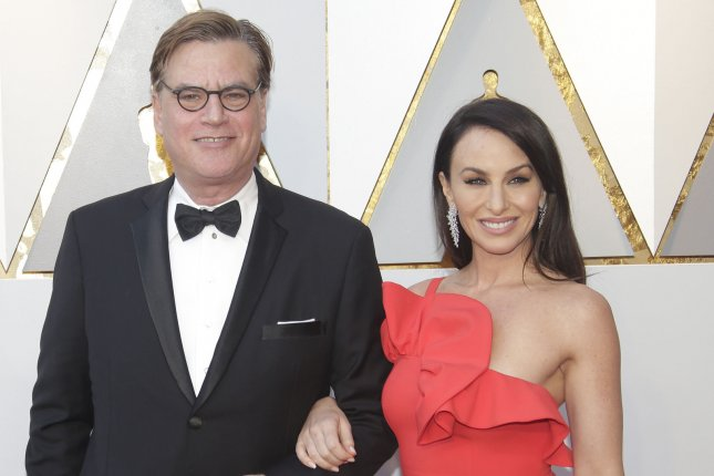 Aaron Sorkin (L), pictured with Molly Bloom, said he has no plans to revive The Newsroom. File Photo by John Angelillo/UPI