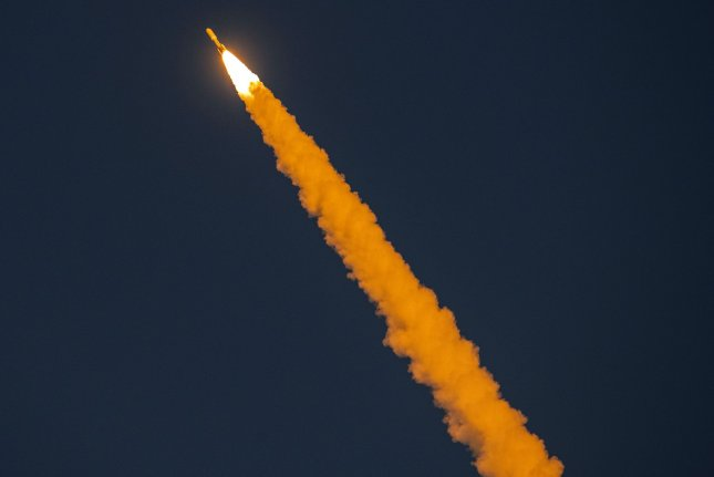 A United Launch Alliance Atlas V rocket streaks through the twilight as it lifts off from Cape Canaveral Air Force Station in Florida on Friday, carrying a classified payload called NROL-101 for the U.S. National Reconnaissance Office. Photo by Pat Benic/UPI
