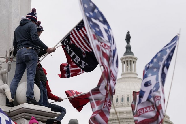 Pro-Trump supporters breach the security perimeter of the U.S. Capitol to protest against the Electoral College vote count that would certify President-elect Joe Biden as the winner in Washington, D.C., on January 6. File Photo by Ken Cedeno/UPI