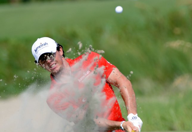 Tournament winner Rory McIlroy of Northern Ireland blasts from the bunker at hole 10 in the final round of the PGA Championship, Aug. 12, 2012, at the Ocean Course in Kiawah Island, S.C.. UPI/David Tulis