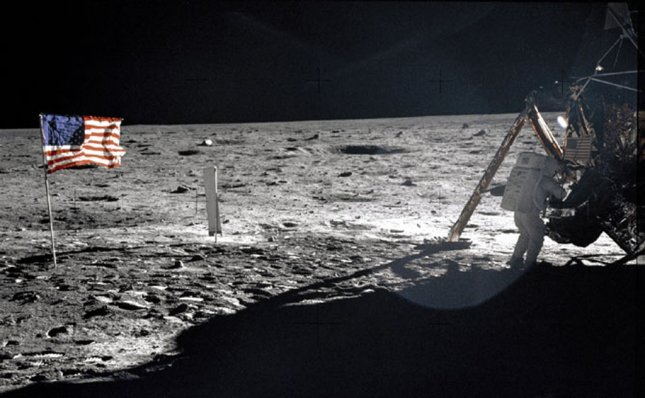 Apollo 11 commander Neil Armstrong, the first man on the moon, works at an equipment storage area on the lunar module July 20, 1969. (This is one of the few photos that show Armstrong on the surface.) NASA/UPI File