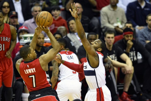 Toronto Raptors guard Kyle Lowry (7) scores against Washington Wizards guard John Wall (2) in the first half of Game 4 of Round 1 of the Eastern Conference Quarterfinals at the Verizon Center in Washington, D.C. on April 26, 2015. Photo by Mark Goldman/UPI