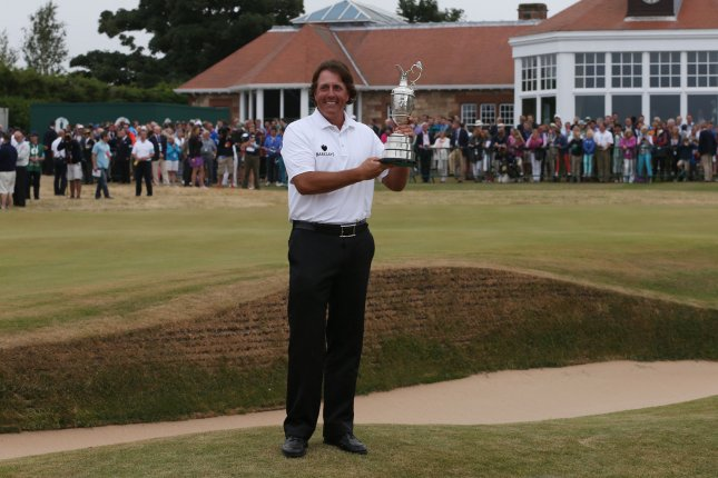 USA's Phil Mickelson holds the Claret Jug after winning the Open Championship at Muirfield on the fourth day of the 2013 Open Championship in Muirfield, Scotland on July 21 , 2013.Mickelson won with a score of three under par. UPI/Hugo Philpott