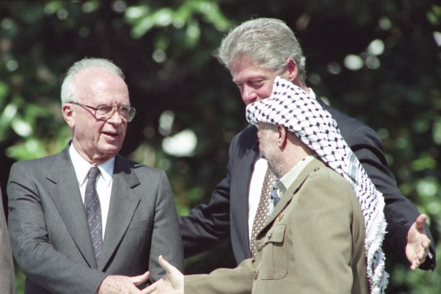 Israeli Prime Minister Yithzak Rabin (L) shakes hands with PLO Chairman Yasser Arafat (R) during peace accord signing ceremonies held on the South Lawn of the White House on September 13, 1993. Rabin was elected prime minister on July 13, 1992. File Photo by Leighton Mark/UPI