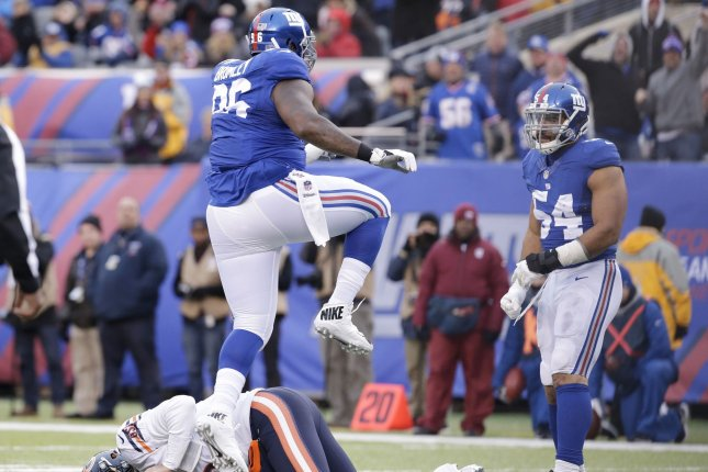 New York Giants Jay Bromley and Olivier Vernon (54) celebrate over Chicago Bears Jay Cutler who reacts after he is sacked in the second half in week 11 of the NFL at MetLife Stadium in East Rutherford, New Jersey on November 20, 2016. File photo by John Angelillo/UPI