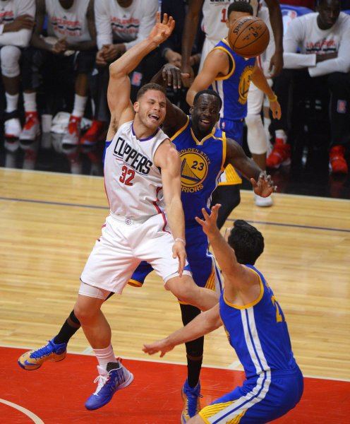 Former Los Angeles Clippers forward Blake Griffin fights for the ball with Golden State Warriors forward Draymond Green during a game last season. Griffin was traded to the Detroit Pistons earlier this week. Photo by Jon SooHoo/UPI