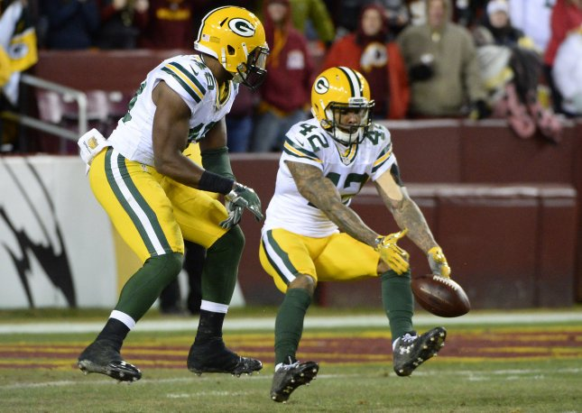 Green Bay Packers defenders Morgan Burnett (42) and Joe Thomas (48) almost intercept a pass during a game against the Washington Redskins during a playoff game in 2016. Photo by David Tulis/UPI