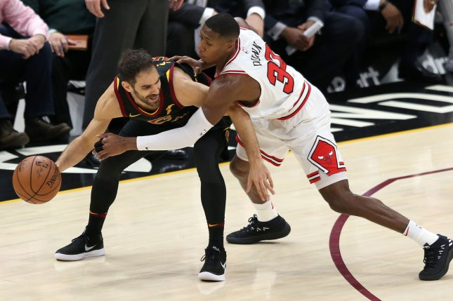 Cleveland Cavaliers' Jose Calderon is guarded closely by Chicago Bulls' Kris Dunn during the second half at Quicken Loans Arena on December 21 in Cleveland, Ohio. Photo by Aaron Josefczyk/UPI