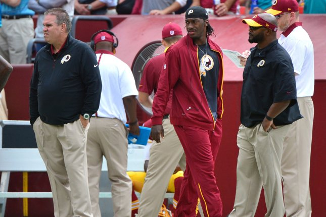 Former Washington Redskins quarterback Robert Griffin III (10) is seen on the sideline in the third quarter against the Miami Dolphins in 2015 at FedEx Field in Landover, Md. File photo by Kevin Dietsch/UPI