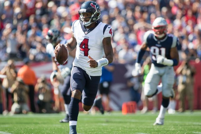 Houston Texans quarterback Deshaun Watson (4) scrambles with the ball in the first quarter against the New England Patriots on September 24, 2017 at Gillette Stadium in Foxborough, Massachusetts. Photo by Matthew Healey/UPI