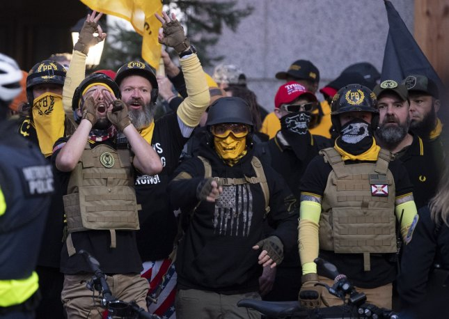 Members of far-right group the Proud Boys yell at counter-protesters at a pro-Trump rally in Washington, D.C., on Saturday, December 12, 2020, when four churches in the city were vandalized. Photo by Kevin Dietsch/UPI