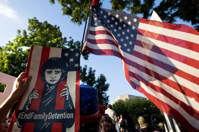 Protesters demonstrate against the Trump administration's immigration policies during the Lights for Liberty rally in Lafayette Square near the White House in Washington, D.C., on July 12, 2019. The Biden administration is pausing most scheduled deportations on Friday for a 100-day review period. File Photo by Pat Benic/UPI