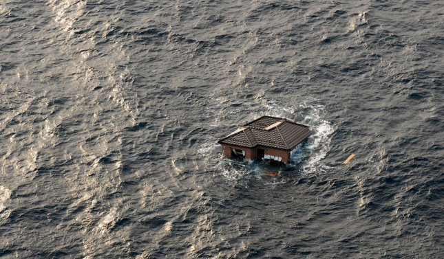 A Japanese home is seen adrift in the Pacific Ocean near Sendai, Japan on March 13, 2011. UPI/Dylan McCord/U.S. Navy