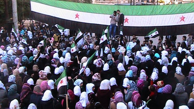 Women protest the government in the Al-qsoor neighborhood of Homs, Syria, on March 19, 2012. UPI