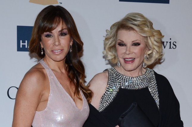 TV Personalities Joan Rivers (R) and Melissa Rivers arrive at the Clive Davis pre-Grammy party and salute to Antonio 'L.A.' Reid at the Beverly Hilton Hotel in Beverly Hills, California on February 9, 2013. UPI/Jim Ruymen