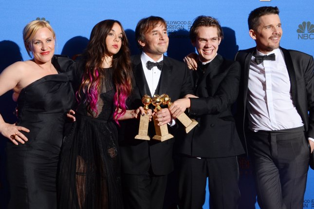 Boyhood' cast and director, (from left) Patricia Arquette, Lorelei Linklater, director Richard Linklater, Ellar Coltrane and Ethan Hawke pose backstage with the Golden Globe for Best Motion Picture, Drama at the Beverly Hilton Hotel in Beverly Hills, California on January 11, 2015. Photo by Jim Ruymen/UPI