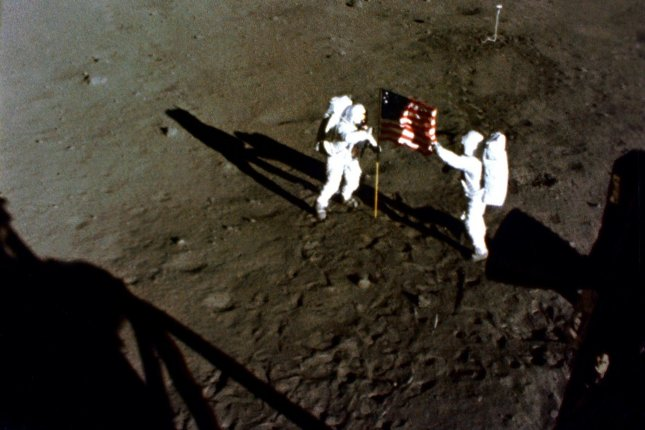 Former Apollo astronauts have up to five times the rate of heart-related deaths as astronauts who remain on Earth or low-Earth orbit, a new study shows. Pictured, astronauts Buzz Aldrin and Neil A. Armstrong place a United States flag on the surface of the Moon during the Apollo 11 mission on July 20, 1969. During the eight-day space mission, Armstrong and Aldrin explored the Moon's surface and brought back rock samples for scientists to study. Michael Collins piloted the command module in the lunar orbit during their 22-hour stay on the moon. UPI File Photo/NASA