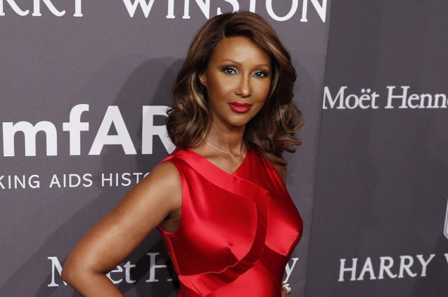 Iman arrives on the red carpet at the 19th annual amfAR New York gala on February 8 in New York City. File Photo by John Angelillo/UPI
