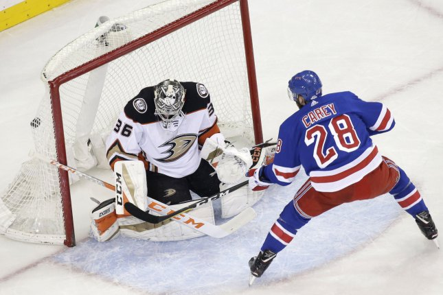 New York Rangers' Paul Carey gets the puck past Anaheim Ducks' John Gibson for a goal in the first period Tuesday at Madison Square Garden in New York City. Photo by John Angelillo/UPI
