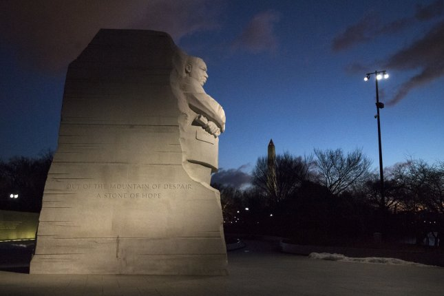 The sun rises on the Martin Luther King Jr. Memorial on Monday. Photo by Kevin Dietsch/UPI