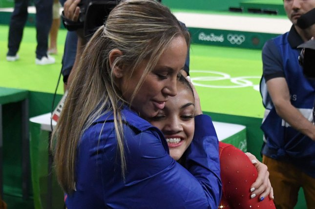 Team USA Gymnastics star Laurie Hernandez (R) provided testimony to a three-person panel about alleged verbal and emotional abuse used by Olympic coach Maggie Haney (L). File Photo by Terry Schmitt/UPI