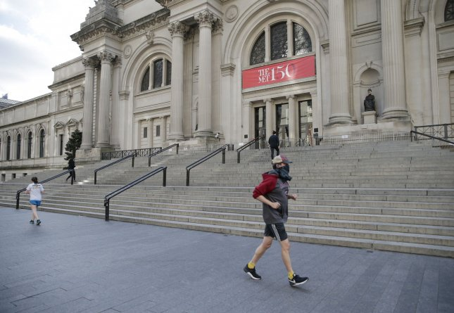 A man jogs by the stairs to The Metropolitan Museum of Art on the first Monday in May where the Met Gala Costume Institute Benefit annual fashion event was postponed due to the coronavirus pandemic at Metropolitan Museum of Art in New York City last Monday. Photo by John Angelillo/UPI