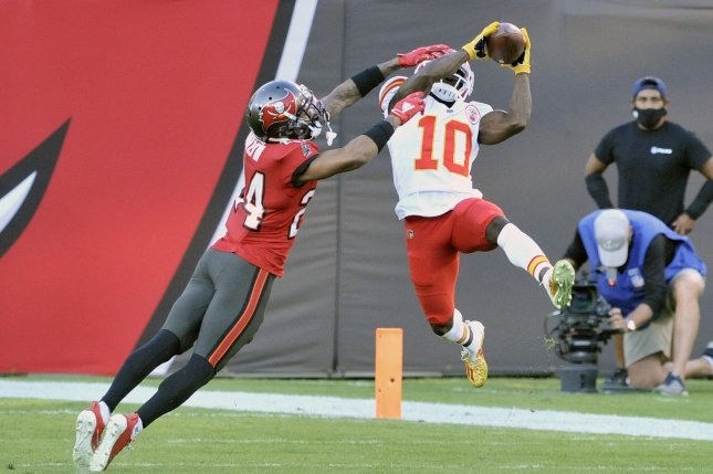 Kansas City Chiefs wide receiver Tyreek Hill (10) makes a catch over Tampa Bay Buccaneers defensive back Carlton Davis III (24) during the first half Sunday at Raymond James Stadium in Tampa, Fla. Photo by Steve Nesius/UPI