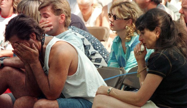 Family members and friends of the deceased passengers of TWA Flight 800 grieve at memorial ceremonies held July 18, 1997, at Mt. Moriches Memorial Park by the local community to remember the 230 passengers that died on July 17, 1996. File Photo by Monika Graff/UPI