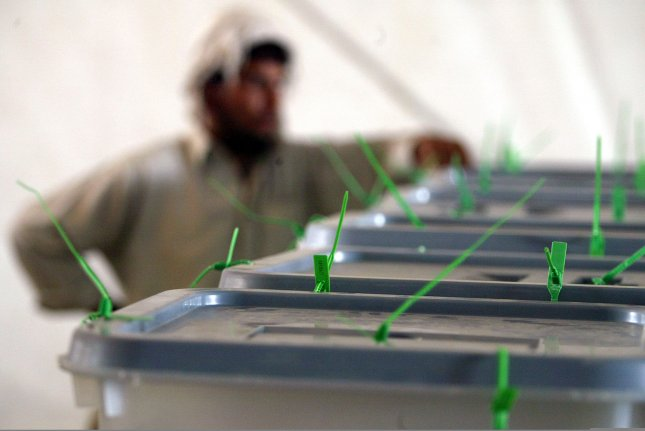 A worker stands next to ballot boxes from the Afghan presidential election at the Independent Election commission of Afghanistan (IEC) base in Kabul, Afghanistan on August 22, 2009. UPI/Mohammad Kheirkhah