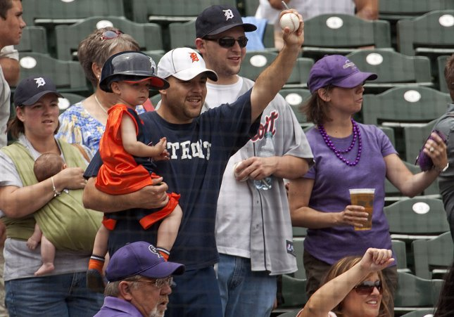 A father-son duo celebrate Father's Day chasing down an autograph from Detroit Tigers manager Jim Leyland before his inter-league game against the Colorado Rockies at Coors Field in Denver on June 15, 2011. UPI/Gary C. Caskey