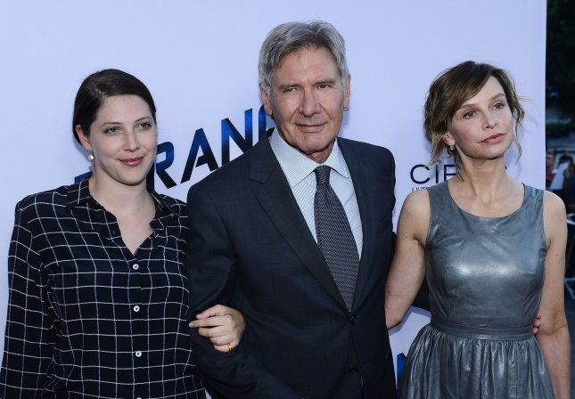 Harrison Ford attended the premiere of Paranoia with his daughter Georgia Ford (L) and wife Calista Flockhart (R) on August 8, 2013. File Photo by Jim Ruymen/UPI