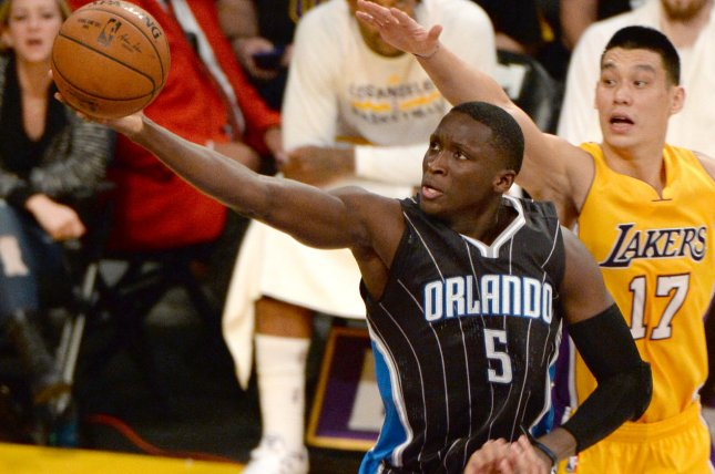 b6c16dedeec6 Former Orlando Magic guard Victor Oladipo(5) scores past Los Angeles Lakers  guard Jeremy Lin (17) during the first half of their NBA game at Staples  Center ...