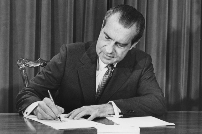 President Richard Nixon signs the message he gave to Congress in which he proposed a $1.1 billion revenue sharing program for rural America, saying it would provide orderly development of rural areas and help them stem migration to the cities. He delivered the message on Capitol Hill on March 10, 1971 in Washington. Photo by Darryl Heikes/UPI