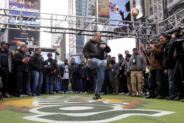 Former Buffalo Bills quarterback Jim Kelly kicks a field goal as he tries to help set a new Guinness World Record title for the most people to kick a successful American football field goal in six consecutive hours in Times Square in New York City. File photo by John Angelillo/UPI