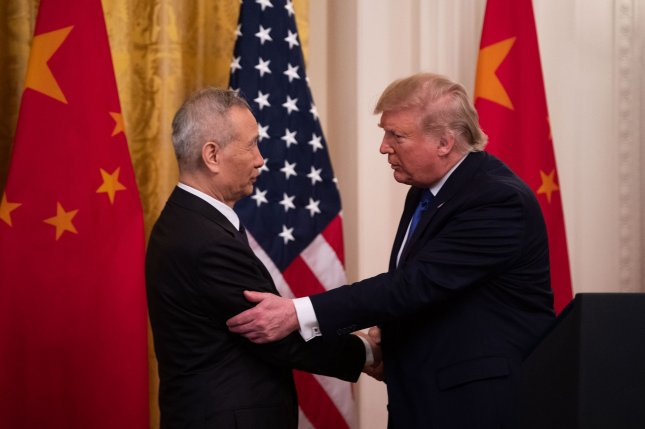 President Donald Trump (R) shakes hands with Chinese Vice Premier Liu He before signing the Phase 1 trade deal between the United States and China  during a ceremony in the East Room at the White House on Wednesday. Photo by Kevin Dietsch/UPI