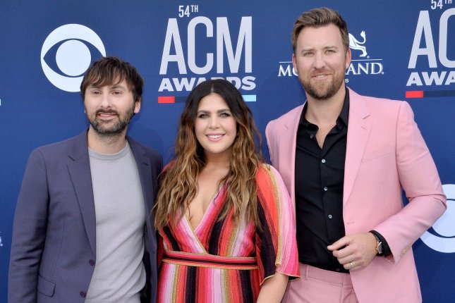 Charles Kelley (R), pictured with Dave Haywood (L) and Hillary Scott, gave a health update after being hospitalized for appendicitis. File Photo by Jim Ruymen/UPI