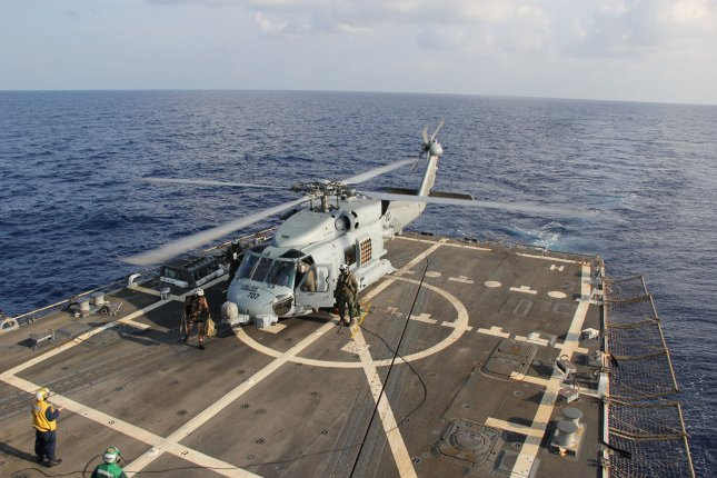 A U.S. Navy MH-60R Sea Hawk helicopter from Helicopter Maritime Strike Squadron (HSM) 78, Det 2, assigned to the guided-missile Destroyer USS Pinckney (DDG 91), lands aboard Pinckney during a crew swap before returning on task in the search and rescue for the missing Malaysian airlines flight MH370, May 10, 2014. The flight had 227 passengers from 14 nations, mainly China, and 12 crew members. According to the Malaysia Airlines website, three Americans, including one infant, were also aboard. UPI/Chris D. Boardman/US Navy