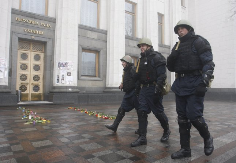 The so-called Maidan self defense unit, wearing police uniforms, carry weapons outside Ukrainian parliament in Kiev on March 4, 2014. UPI/Ivan Vakolenko
