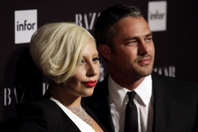 Lady Gaga (L) denied she and fiancé Taylor Kinney are expecting in concert Sunday. File photo by John Angelillo/UPI