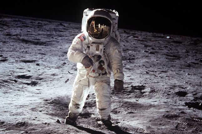 Astronaut Buzz Aldrin, lunar module pilot, walks on the surface of the Moon near the leg of the Lunar Module (LM) Eagle, during the Apollo 11 extravehicular activity (EVA). Astronaut Neil Armstrong, commander, took this photograph with a 70mm lunar surface camera. While astronauts Armstrong and Aldrin descended in the Lunar Module (LM) to explore the Sea of Tranquility region of the Moon, astronaut Michael Collins, command module pilot, remained with the Command and Service Modules (CSM) in lunar orbit. Photo by NASA/UPI