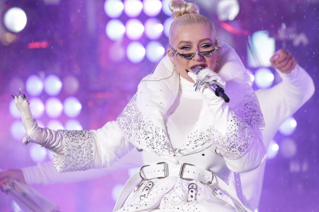Christina Aguilera performs in the rain on New Year's Rockin' Eve on Monday in Times Square in New York City. Photo by John Angelillo/UPI