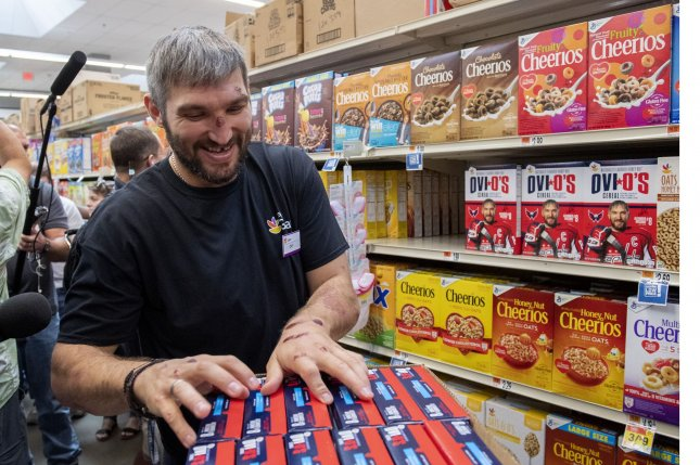 Washington Capitals captain Alexander Ovechkin stocks the shelves with his own Ovi O's cereal Tuesday at a Giant Supermarket in Washington, D.C. Photo by Pat Benic/UPI