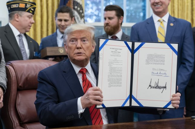 President Donald Trump participates in a signing ceremony for S. 153, the Supporting Veterans in STEM Careers Act at the White House on Tuesday. Photo by Chris Kleponis/UPI