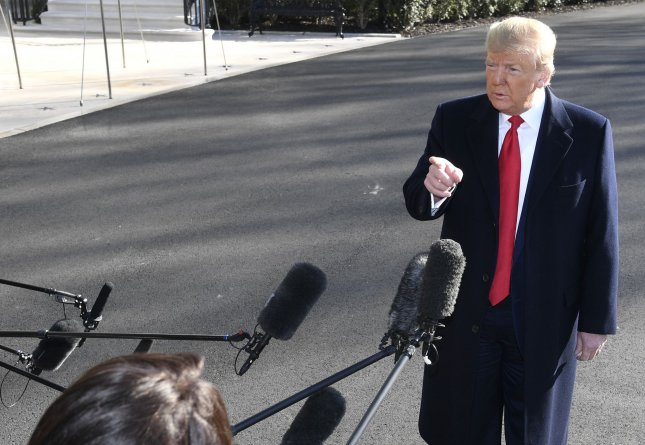 President Donald Trump responds to a question from the press prior to departing the White House with First Lady Melania Trump for a trip to India, Sunday, February 23, 2020, in Washington, DC. Trump is reciprocating for a visit by India's Prime Minister Narendra Modi to the U.S. last year. Photo by Mike Theiler/UPI
