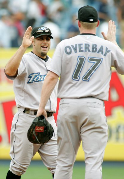 Reed Johnson (L) outfielder for the Toronto Blue Jays, celebrates with first baseman Lyle Overbay after defeating the the New York Yankees 3-2 in nine innings at Yankee Stadium in New York on July 19, 2007. (UPI Photo/Monika Graff)