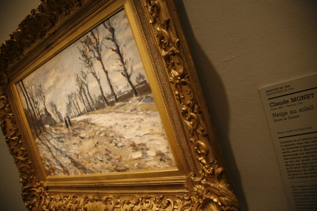 Claude Monet's Snow at Sunset hangs on the wall at the opening of an exhibition in Paris on June 25, 2008. The exhibition, taking place at the Jewish Art and History Museum, features precious art pieces that were stolen from Jewish homes during the Nazi occupation of France during World War II. (UPI Photo/David Silpa)