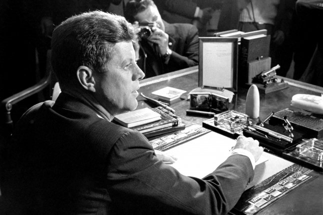 President John F. Kennedy is seen in this October 23, 1962 file photo after signing a proclamation formally putting into effect the U.S. arms quarantine against Cuba. File photo UPI